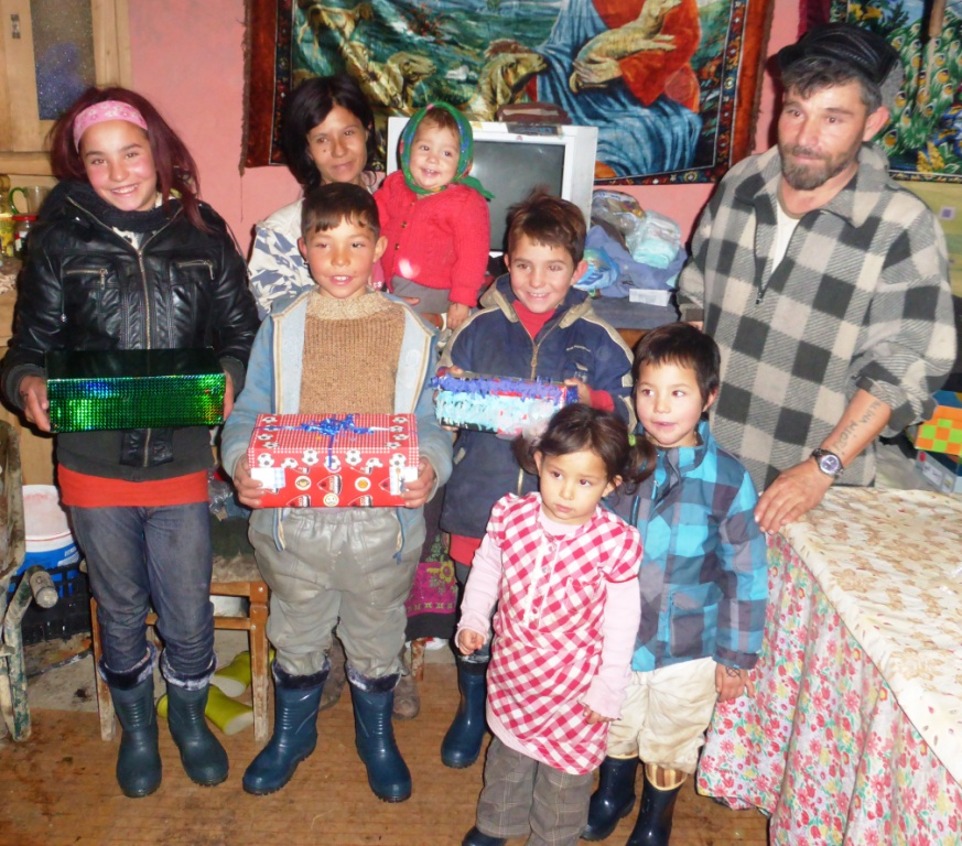 A family from Albești; they received boots, clothes, bread and presents
